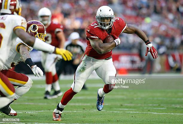 Running back David Johnson of the Arizona Cardinals runs for a first down against the Washington Redskins during the second quarter of a game at...