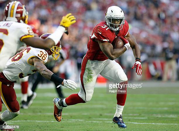 Running back David Johnson of the Arizona Cardinals runs for a first down as Su'a Cravens of the Washington Redskins attempts to make a tackle during...