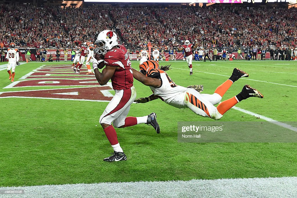 Running back David Johnson of the Arizona Cardinals runs past linebacker Vontaze Burfict of the Cincinnati Bengals for a touchdown during the third...