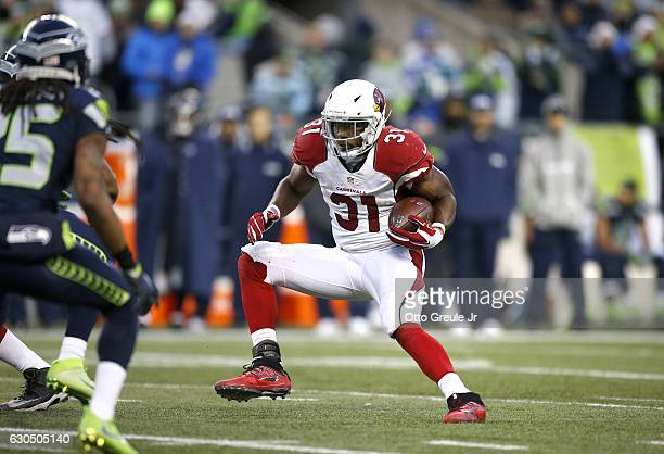 Running back David Johnson of the Arizona Cardinals rushes against the Seattle Seahawks at CenturyLink Field on December 24 2016 in Seattle Washington