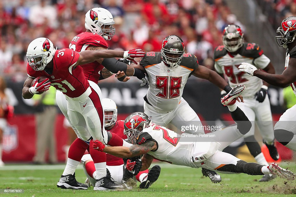 Running back David Johnson #31 of the Arizona Cardinals rushes the football past strong safety Chris Conte #23 of the Tampa Bay Buccaneers during the second quarter of the NFL game at the University of Phoenix Stadium on September 18, 2016 in Glendale, Arizona.