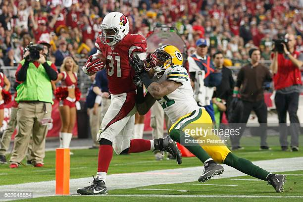 Running back David Johnson of the Arizona Cardinals scores a 14 yard rushing touchdown against free safety Ha Ha ClintonDix of the Green Bay Packers...