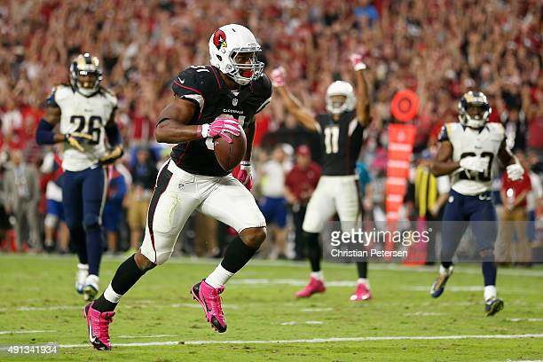 Running back David Johnson of the Arizona Cardinals scores a 23 yard touchdown reception against the St Louis Rams during the fourth quarter of the...