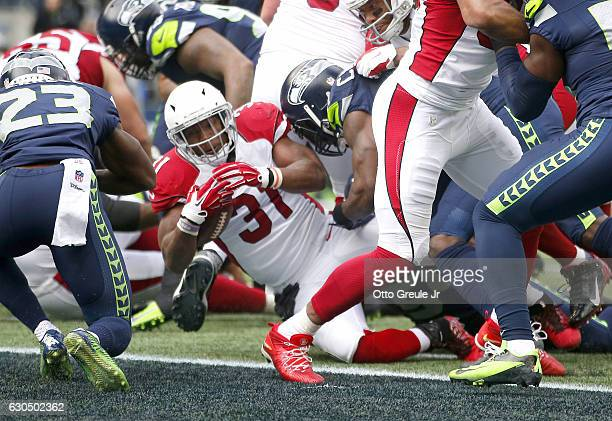 Running back David Johnson of the Arizona Cardinals scores a touchdown against the Seattle Seahawks at CenturyLink Field on December 24 2016 in...