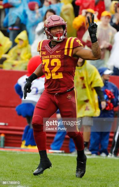 Running back David Montgomery of the Iowa State Cyclones celebrates a touchdown in the first half of play at Jack Trice Stadium on October 14 2017 in...