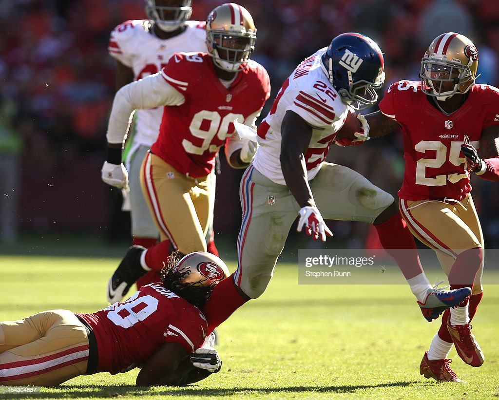 Running back <a gi-track='captionPersonalityLinkClicked' href=/galleries/search?phrase=David+Wilson+-+American+Football+Running+Back&family=editorial&specificpeople=9642682 ng-click='$event.stopPropagation()'>David Wilson</a> #22 of the New York Giants carries the ball against safety <a gi-track='captionPersonalityLinkClicked' href=/galleries/search?phrase=Dashon+Goldson&family=editorial&specificpeople=2167242 ng-click='$event.stopPropagation()'>Dashon Goldson</a> #38 of the San Francisco 49ers at Candlestick Park on October 14, 2012 in San Francisco, California. The Giants won 26-3.