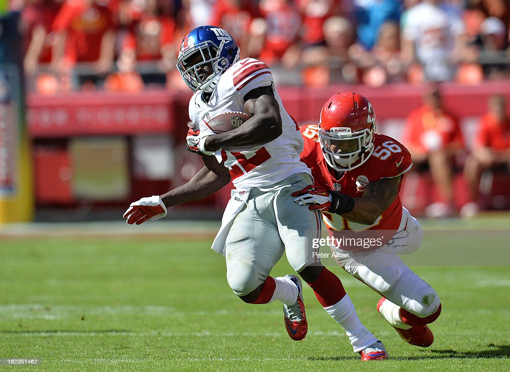 Running back <a gi-track='captionPersonalityLinkClicked' href=/galleries/search?phrase=David+Wilson+-+American+Football+Running+Back&family=editorial&specificpeople=9642682 ng-click='$event.stopPropagation()'>David Wilson</a> #22 of the New York Giants rushes past linebacker <a gi-track='captionPersonalityLinkClicked' href=/galleries/search?phrase=Derrick+Johnson+-+American+Football+Player&family=editorial&specificpeople=226781 ng-click='$event.stopPropagation()'>Derrick Johnson</a> #56 of the Kansas City Chiefs during the second half on September 29, 2013 at Arrowhead Stadium in Kansas City, Missouri. Kansas City defeated New York 31-7.
