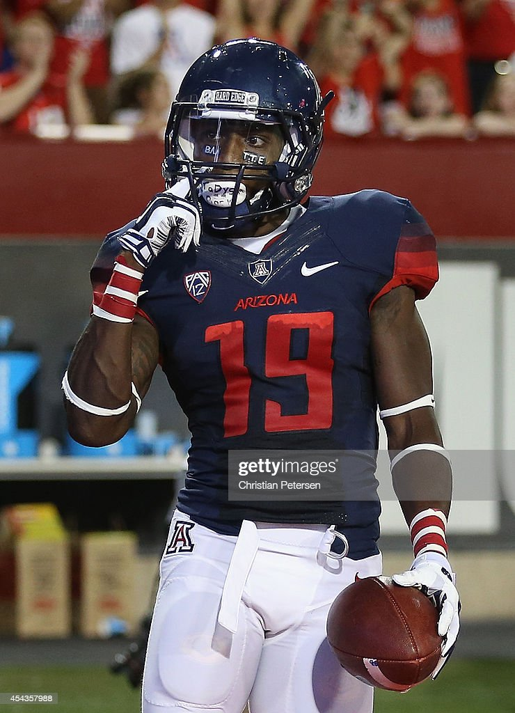 Running back <a gi-track='captionPersonalityLinkClicked' href=/galleries/search?phrase=Davonte%27+Neal&family=editorial&specificpeople=9725369 ng-click='$event.stopPropagation()'>Davonte' Neal</a> #19 of the Arizona Wildcats reacts after catching a 13 yard touchdown reception against the UNLV Rebels during the second quarter of the college football game at Arizona Stadium on August 29, 2014 in Tucson, Arizona.
