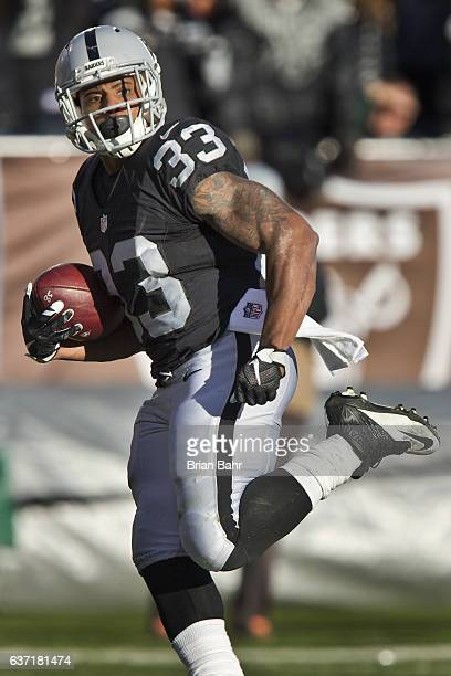Running back DeAndre Washington of the Oakland Raiders runs for his second 22yard touchdown against the Indianapolis Colts in the third quarter on...