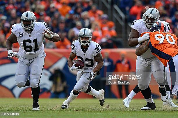 Running back DeAndre Washington of the Oakland Raiders rushes against the Denver Broncos in the first quarter of a game at Sports Authority Field at...