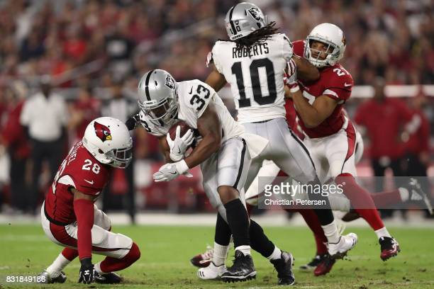 Running back DeAndre Washington of the Oakland Raiders rushes the football against cornerback Justin Bethel of the Arizona Cardinals during the NFL...