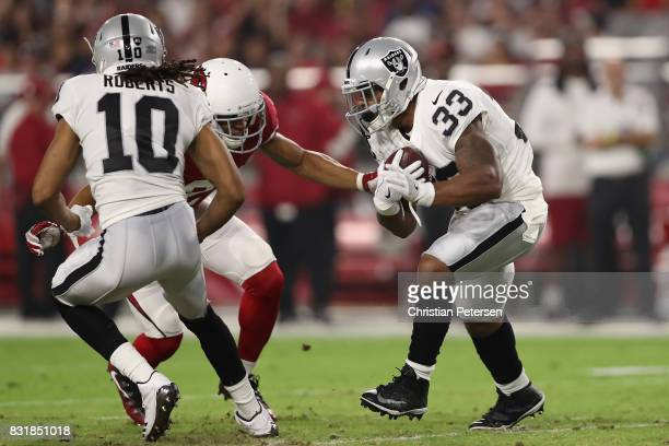 Running back DeAndre Washington of the Oakland Raiders rushes the football against the Arizona Cardinals during the NFL game at the University of...