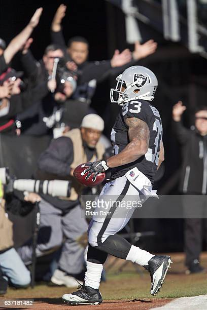 Running back DeAndre Washington of the Oakland Raiders scores on his second 22yard touchdown against the Indianapolis Colts in the third quarter on...