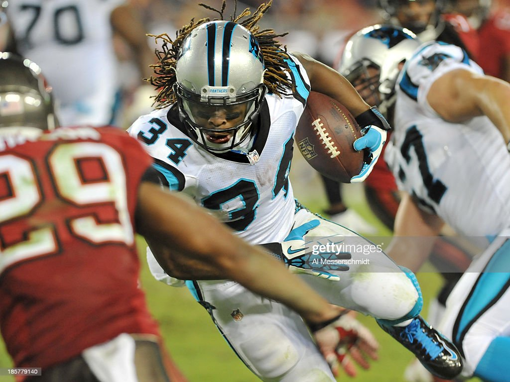 Running back <a gi-track='captionPersonalityLinkClicked' href=/galleries/search?phrase=DeAngelo+Williams&family=editorial&specificpeople=618130 ng-click='$event.stopPropagation()'>DeAngelo Williams</a> #34 of the Carolina Panthers runs upfield against the Tampa Bay Buccaneers October 24, 2013 at Raymond James Stadium in Tampa, Florida. Carolina won 31 - 13.