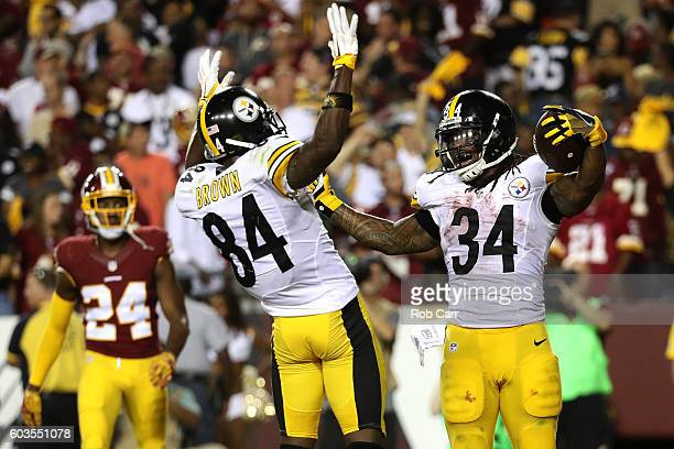 Running back DeAngelo Williams of the Pittsburgh Steelers celebrates with teammate wide receiver Antonio Brown after scoring a fourth quarter...
