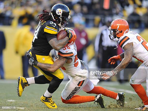 Running back DeAngelo Williams of the Pittsburgh Steelers is tackled by linebacker Christian Kirksey of the Cleveland Browns during a game on January...