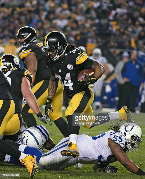 Running back DeAngelo Williams of the Pittsburgh Steelers leaps over linebacker Nate Irving of the Indianapolis Colts as he runs with the football...