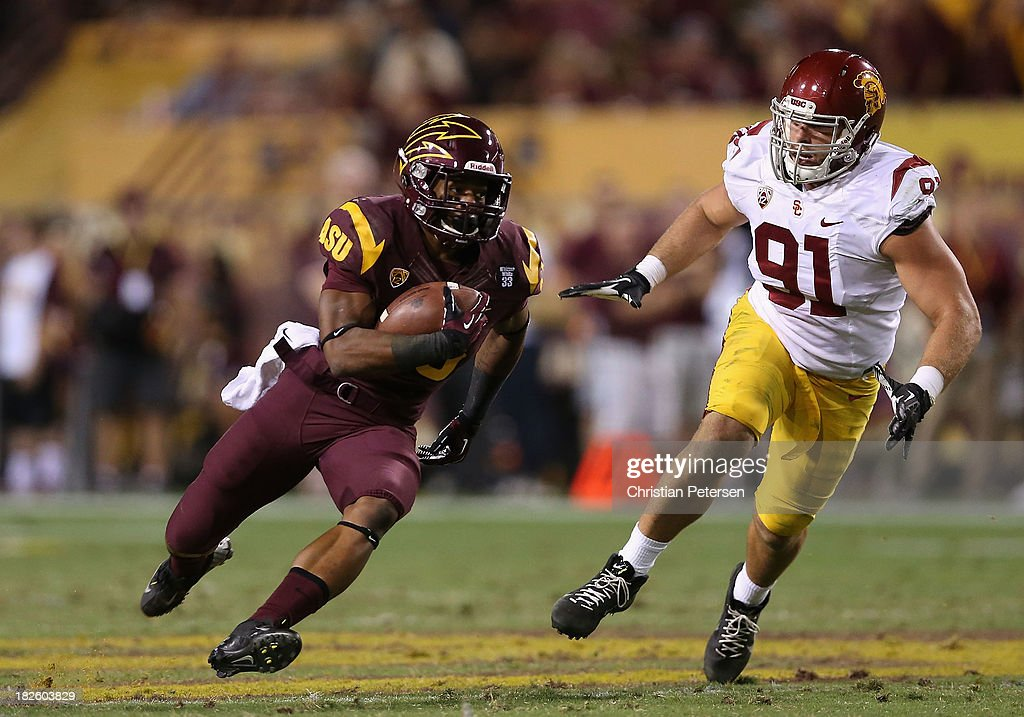 Running back Deantre Lewis #25 of the Arizona State Sun Devils rushes the football against the USC Trojans during the college football game at Sun Devil Stadium on September 28, 2013 in Tempe, Arizona. The Sun Devils defeated the Trojans 62-41.