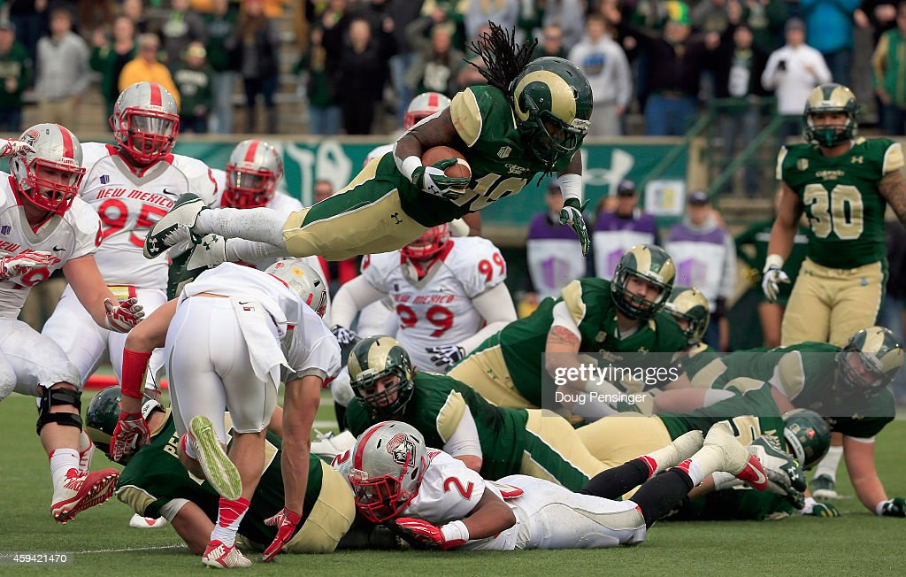 Running back Dee Hart of the Colorado State Rams dives into the endzone on fourth down for a touchdown to take a 140 lead against the New Mexico...