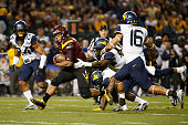 Running back Demario Richard of the Arizona State Sun Devils rushes the football against cornerback Mykal Manswell of the West Virginia Mountaineers...