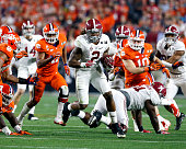 Running back Derrick Henry of the Alabama Crimson Tide breaks a few tackles on a running play during the College Football National Championship Game...