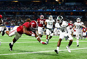 Running back Derrick Henry of the Alabama Crimson Tide dives for a touchdown in the fourth quarter against the Michigan State Spartans during the...