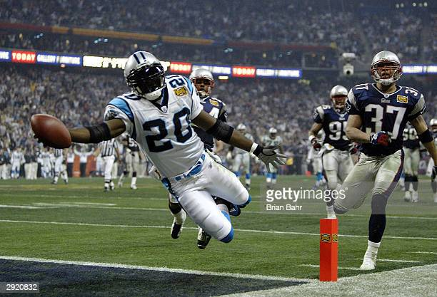 Running back DeShaun Foster of the Carolina Panthers scores on a 33 yard touchdown run against the New England Patriots during Super Bowl XXXVIII at...