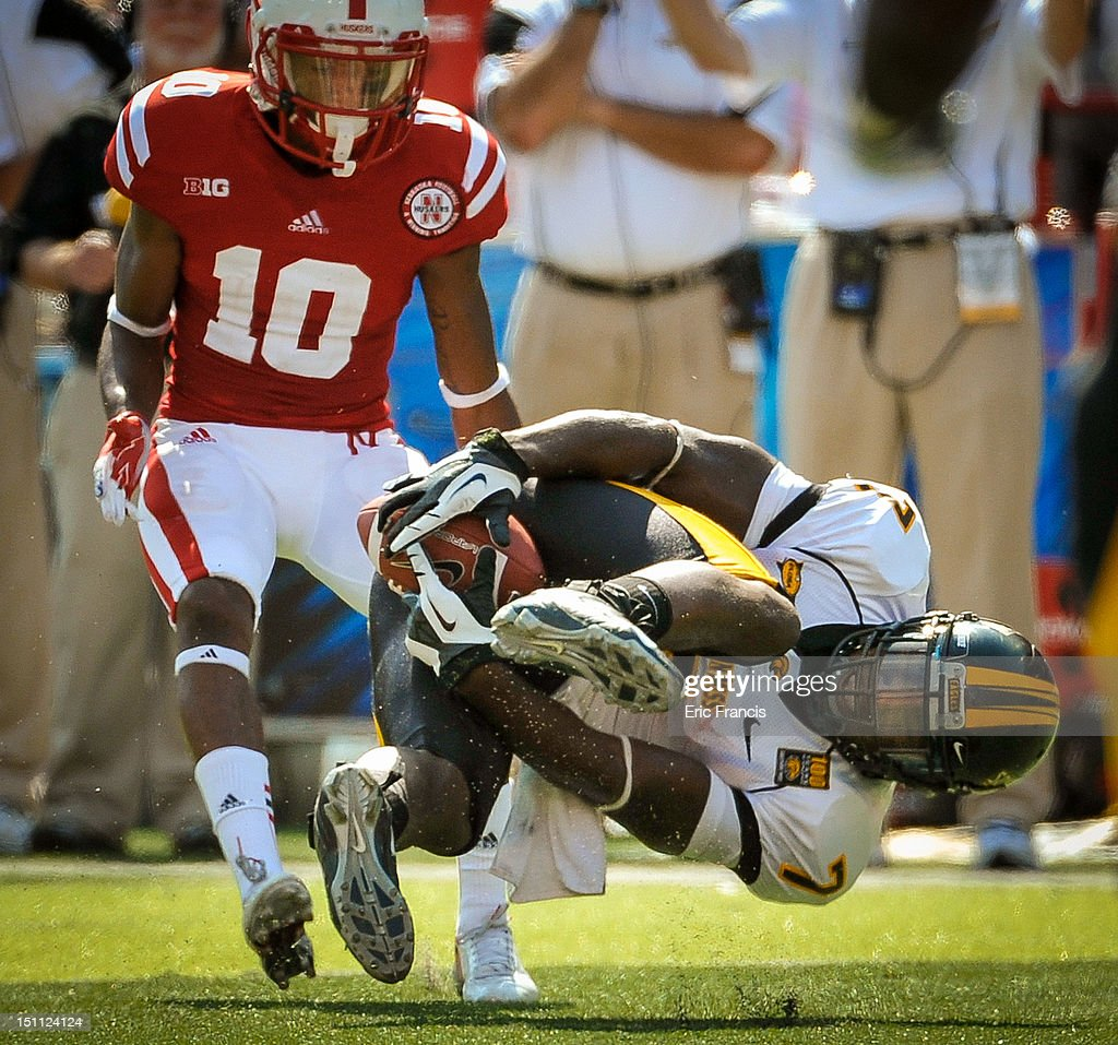 Running back Desmond Johnson #7 of the Southern Miss Golden Eagles tries to bring in a pass while being watched by cornerback Josh Mitchell #10 of the Nebraska Cornhuskers during their game at Memorial Stadium September 1, 2012 in Lincoln, Nebraska. Nebraska won 40-20.