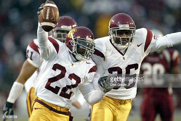 Running back Desmond Reed of the USC Trojans celebrates with safety Josh Pinkard after recovering a fumble on a kickoff against the Washington State...