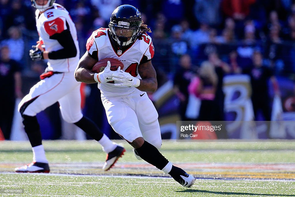 Running back Devonta Freeman of the Atlanta Falcons carries in the second half of a game against the Baltimore Ravens at MT Bank Stadium on October...