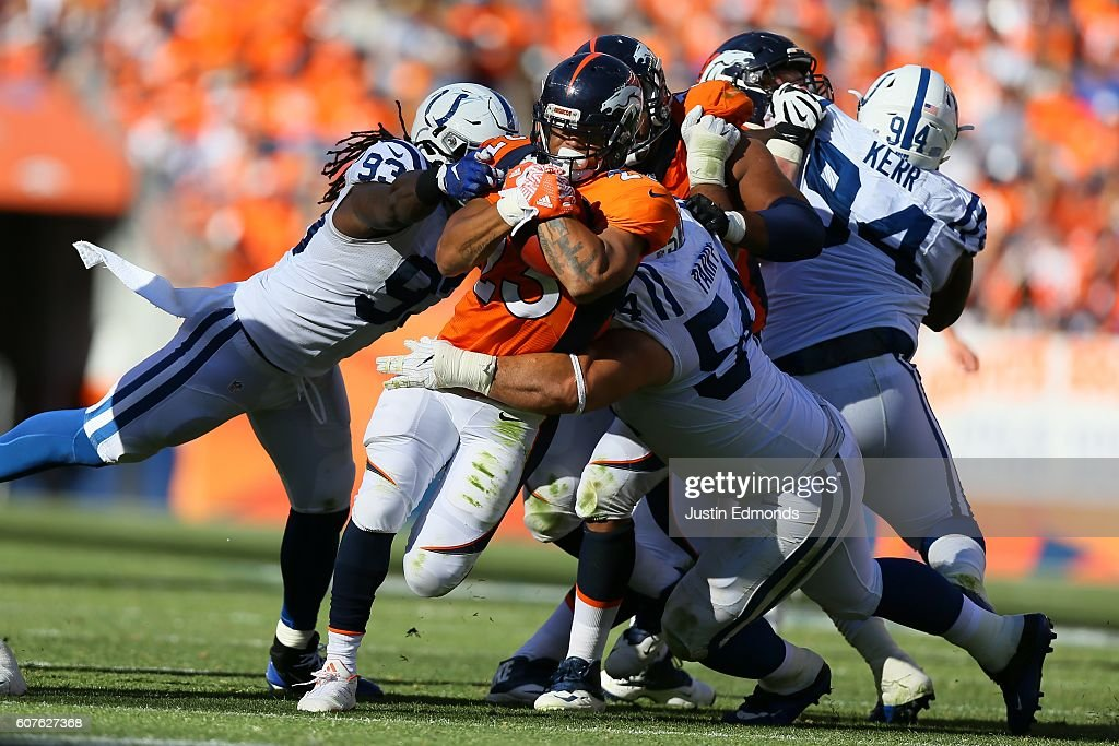 Running back Devontae Booker #23 of the Denver Broncos is tackled by outside linebacker Erik Walden #93 and nose tackle David Parry #54 of the Indianapolis Colts at Sports Authority Field at Mile High on September 18, 2016 in Denver, Colorado.