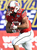 Running back Devontae Booker of the Utah Utes runs for yardage against the Colorado State Rams during the Royal Purple Las Vegas Bowl at Sam Boyd...