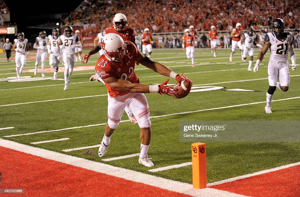 Running back Devontae Booker of the Utah Utes scores a first quarter touchdown against the California Golden Bears at RiceEccles Stadium on October...