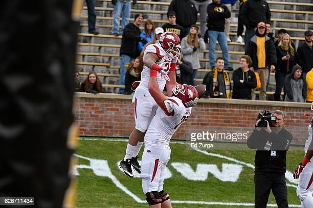 Running back Devwah Whaley of the Arkansas Razorbacks celebrates his touchdown with offensive lineman Dan Skipper of the Arkansas Razorbacks against...