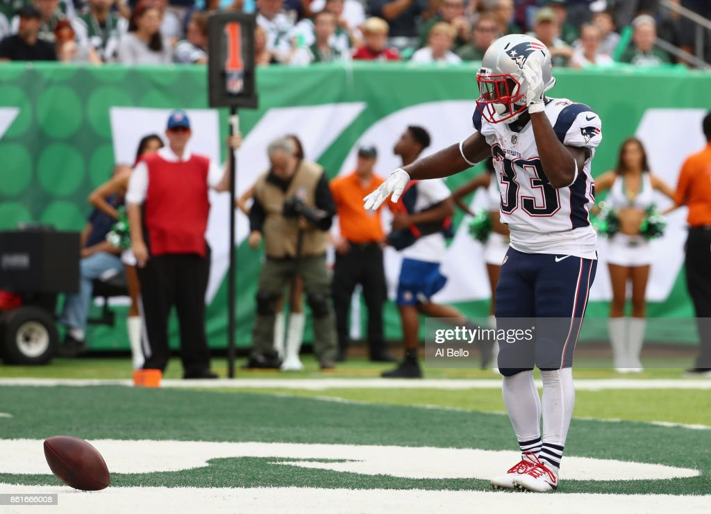 Running back Dion Lewis #33 of the New England Patriots celebrates his touchdown against the New York Jets during the second quarter of their game at MetLife Stadium on October 15, 2017 in East Rutherford, New Jersey.