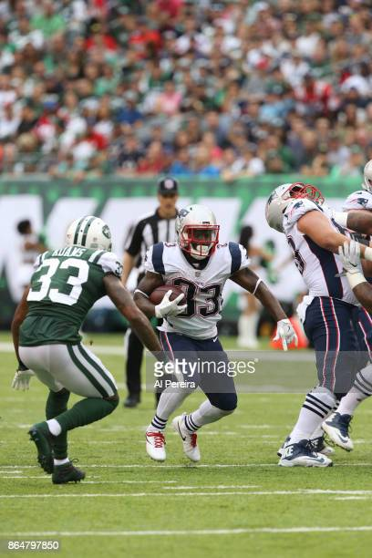 Running Back Dion Lewis of the New England Patriots in action against the New York Jets during their game at MetLife Stadium on October 15 2017 in...