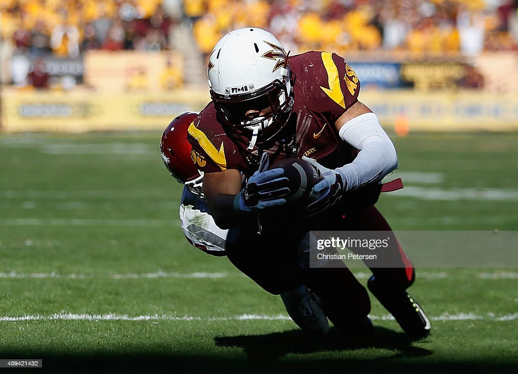 Running back DJ Foster of the Arizona State Sun Devils dives into the endzone to score on a 18 yard rushing touchdown past safety Darius Lemora of...