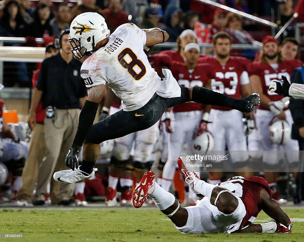Running back D.J. Foster #8 of the Arizona State Sun Devils leaps in the air to avoid a tackle during the fourth quarter against the Arizona State Sun Devils at Stanford Stadium on September 21, 2013 in Stanford, California. The Cardinals defeated the Sun Devils 42-28.