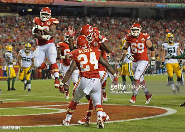 Running back DJ White of the Kansas City Chiefs celebrates with his teammates after scoring a touchdown against the Green Bay Packers during the...