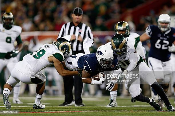 Running back Don Jackson of the Nevada Wolf Pack dives with the football as he rushes against the Colorado State Rams during the fourth quarter of...