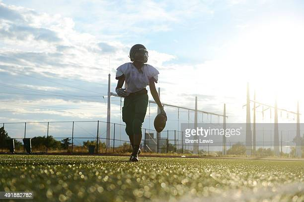 Running back Don'dre Beckworth walks back during a hand off drill during practice October 7 2015 at George Washington High School Washington High...