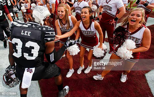 Running back Dontavian Lee of the Mississippi State Bulldogs celebrates with cheerleaders after the end of an NCAA college football game at Davis...