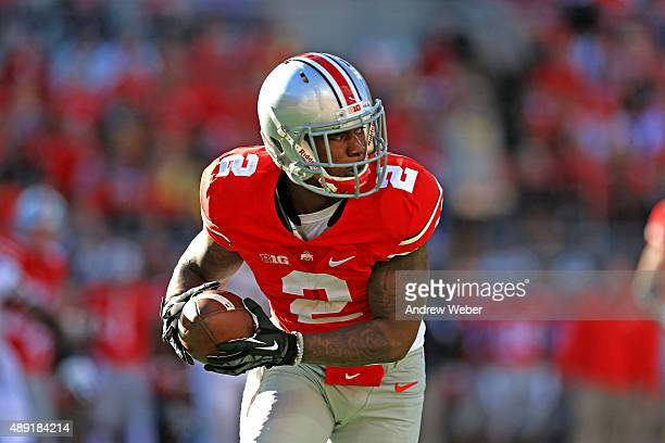 Running back Dontre Wilson of the Ohio State Buckeyes makes a catch in the third quarter against the Northern Illinois Huskies at Ohio Stadium on...