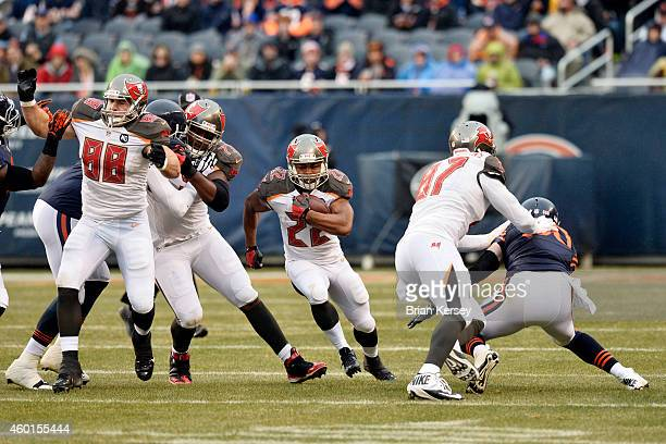 Running back Doug Martin of the Tampa Bay Buccaneers carries the ball during the NFL game against the Chicago Bears on November 23 2014 at Soldier...