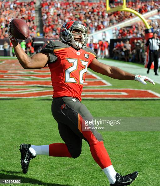Running back Doug Martin of the Tampa Bay Buccaneers carries the ball into the endzone for a touchdown at Raymond James Stadium on November 30 2014...
