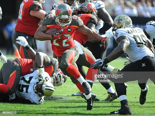 Running back Doug Martin of the Tampa Bay Buccaneers carries the ball against the New Orleans Saints at Raymond James Stadium on December 28 2014 in...