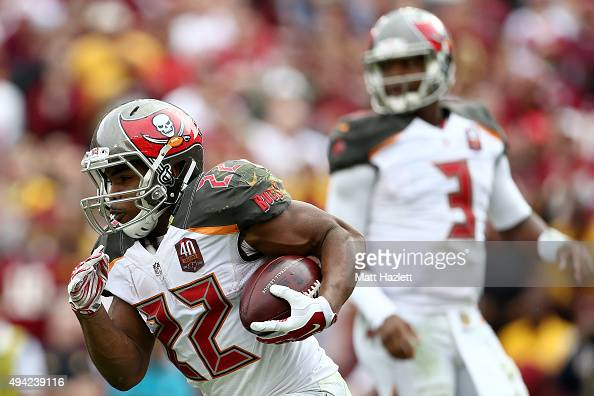 Running back Doug Martin of the Tampa Bay Buccaneers carries the ball in the third quarter of a game against the Washington Redskins at FedExField on...