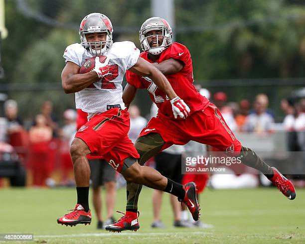 Running back Doug Martin of the Tampa Bay Buccaneers catches a pass over corner back Alterraun Verner during Training Camp at One Buc Place on August...