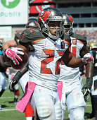 Running back Doug Martin of the Tampa Bay Buccaneers celebrates a second quarter touchdown at Raymond James Stadium on October 11 2015 in Tampa...