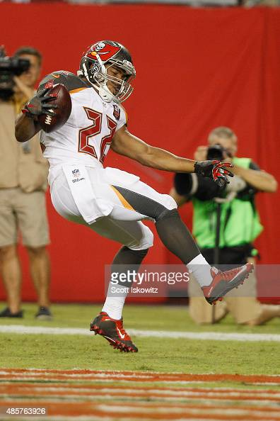 Running back Doug Martin of the Tampa Bay Buccaneers celebrates his touchdown run in the second quarter of the preseason game between the Tampa Bay...